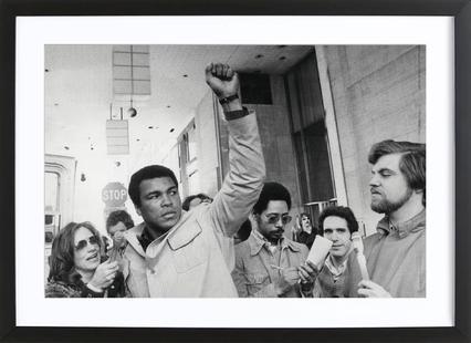 Muhammad Ali raises his Fist