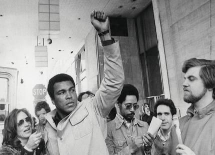Muhammad Ali raises his Fist