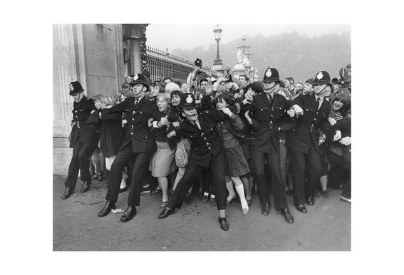 Beatles receiving their MBE's, 1965