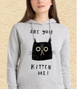 Woman wearing a grey hoodie with an Are you kitten me? cat design