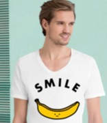 Man wearing a white T-shirt with a banana motif and the word smile printed on it