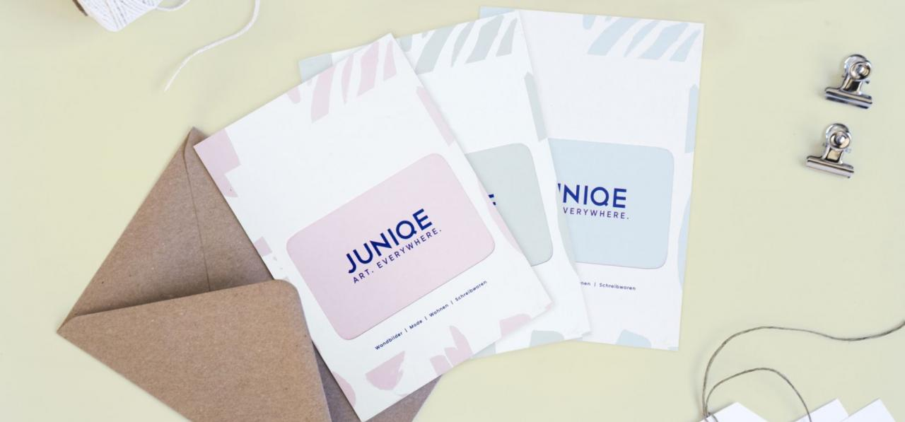 juniqe gift card and greeting card on table