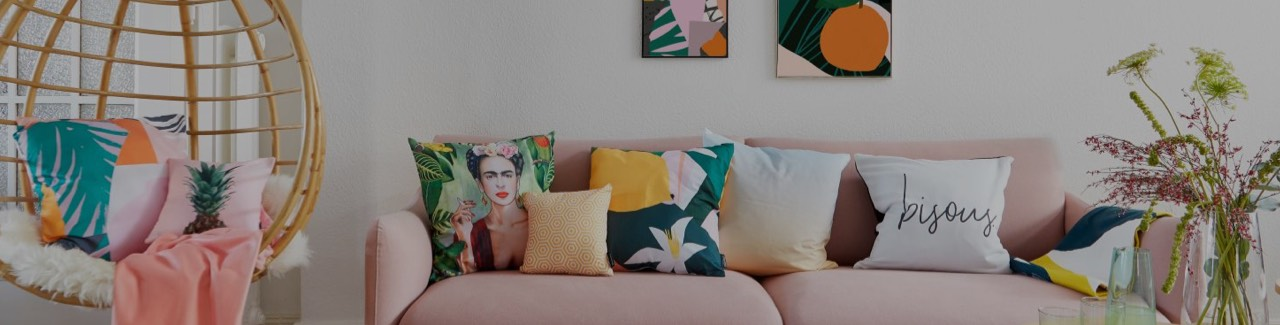 colourful printed and patterend cushions on sofa in living room