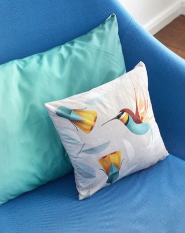small square cushion with yellow bird print and large turqoise cushion