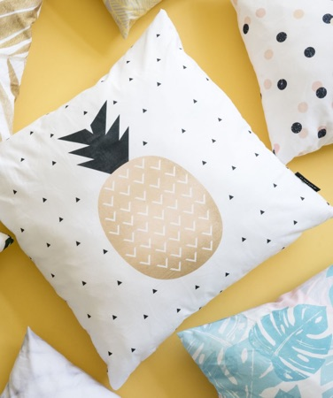 White cushion with a geometric pineapple motif
