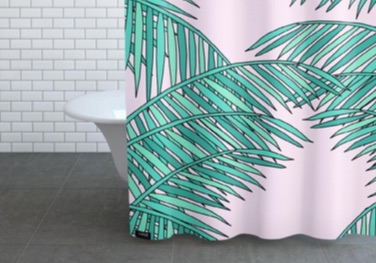 Shower curtain with a palm leaf motif