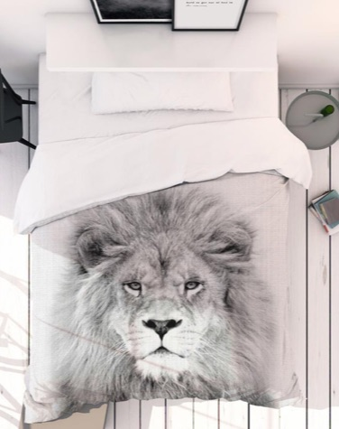 White bedroom with a black and white lion duvet cover