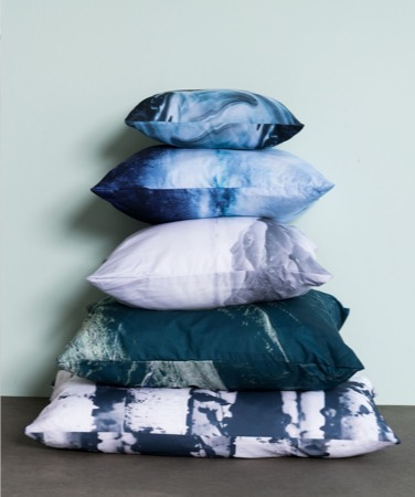 Pile of cushions with abstract prints from JUNIQE
