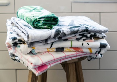 Pile of towels with different designs from JUNIQE