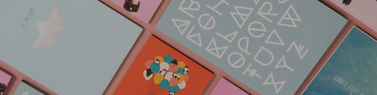 Selection of notebooks with various designs including an alphabet and some penguins riding balloons
