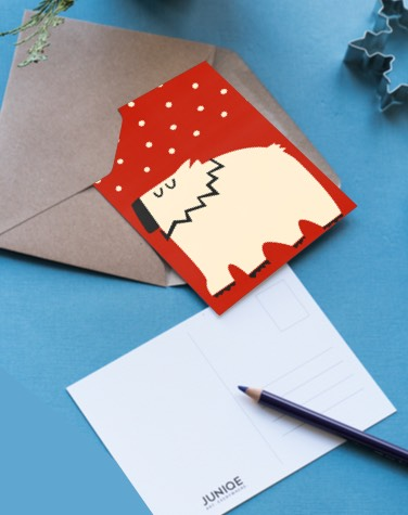 Red postcard with polar bear design in envelope