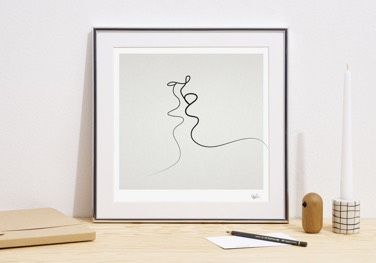 peytil kiss line art poster in aluminium frame leaning against wall