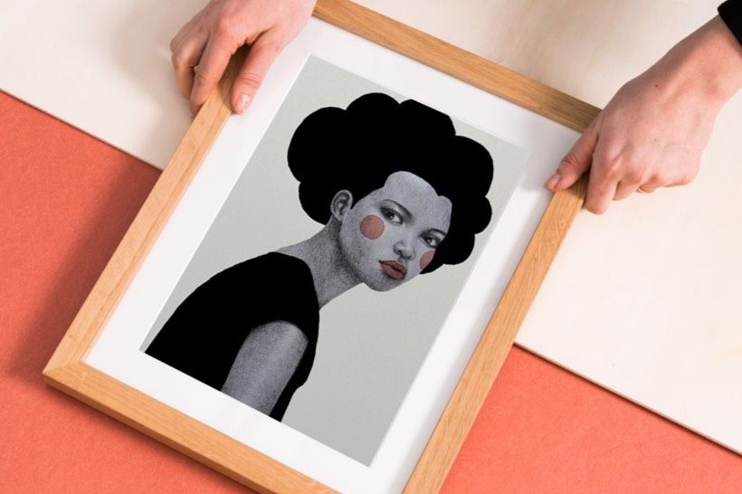 black and white illustration of woman in wooden frame