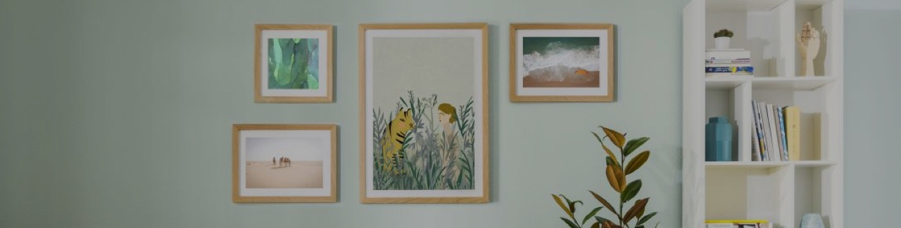 Gallery wall with framed tiger and Sahara posters in a living room