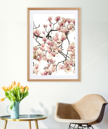 Floral print in a wooden frame on a wall