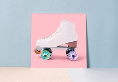 Acrylic glass print with a roller skate motif on a pink background