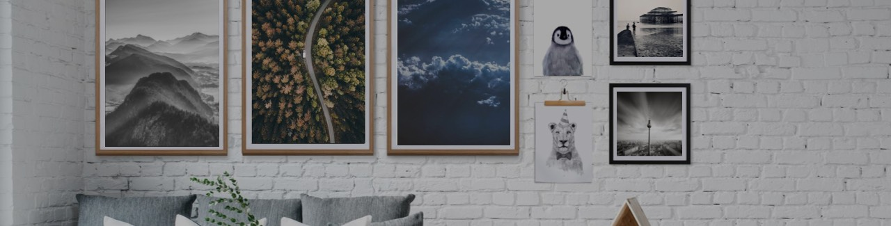 Framed posters by JUNIQE against a white wall