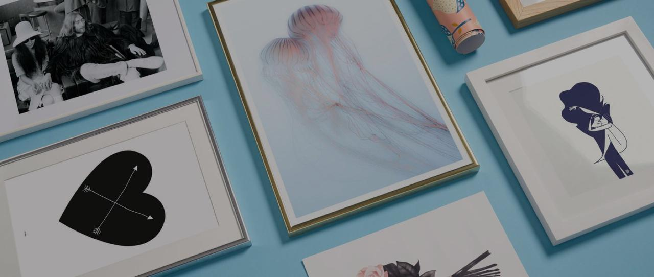 framed prints with jellyfish, heart and couple motifs