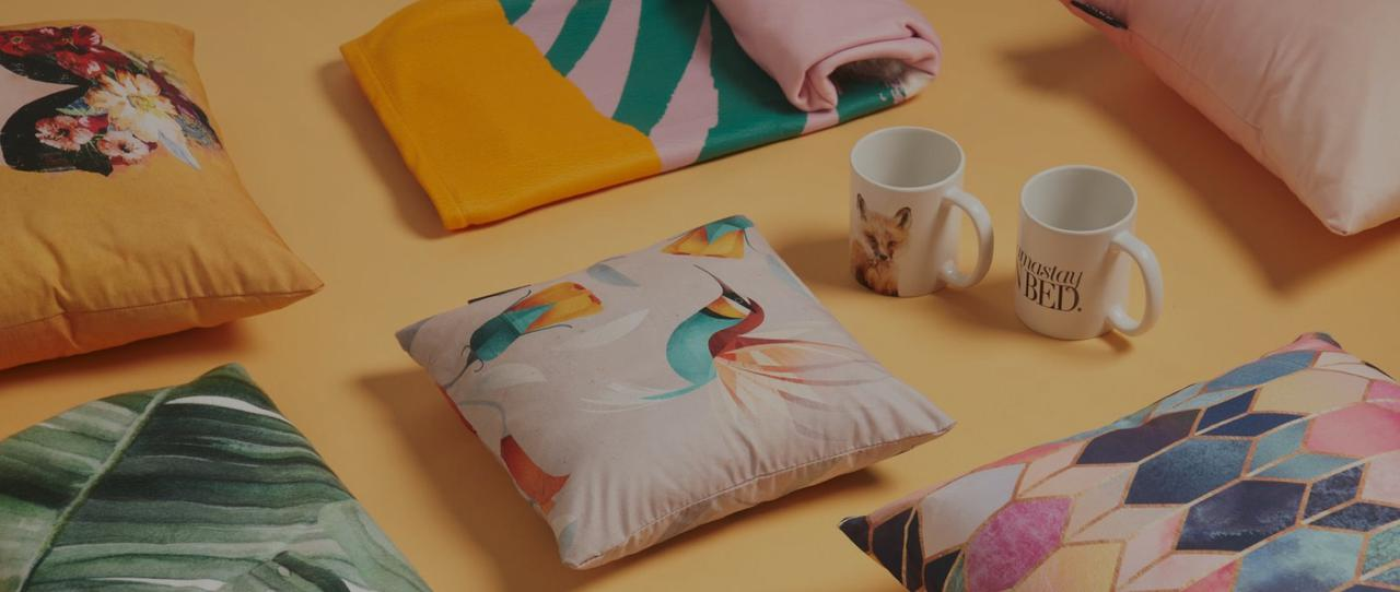 Cushions and fleece blankets with colourful designs