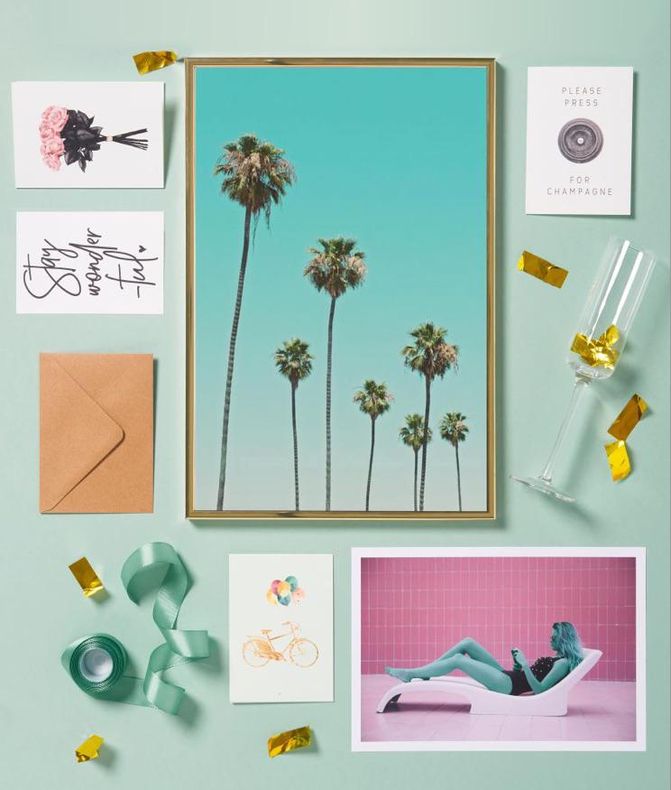 framed print of palm trees and greeting cards with stay wonderful, rose and champagne motifs