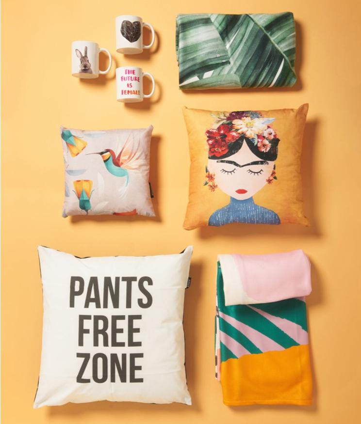 cushions with pants free zone and frida kahlo motifs and beach towels from JUNIQUE