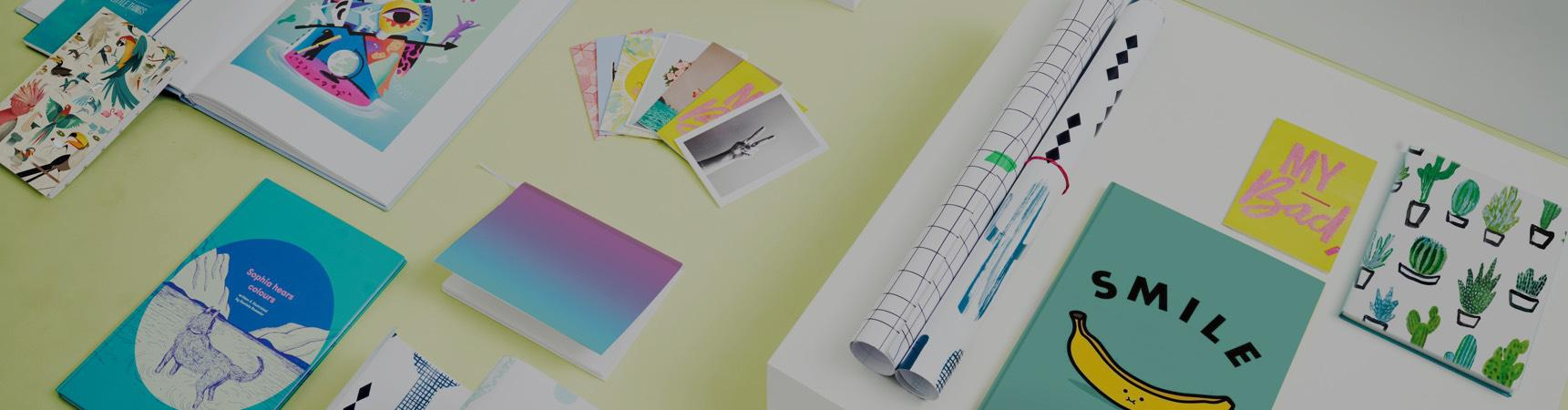 Colourful postcards, notebooks, childrens' books and wrapping paper from JUNIQE