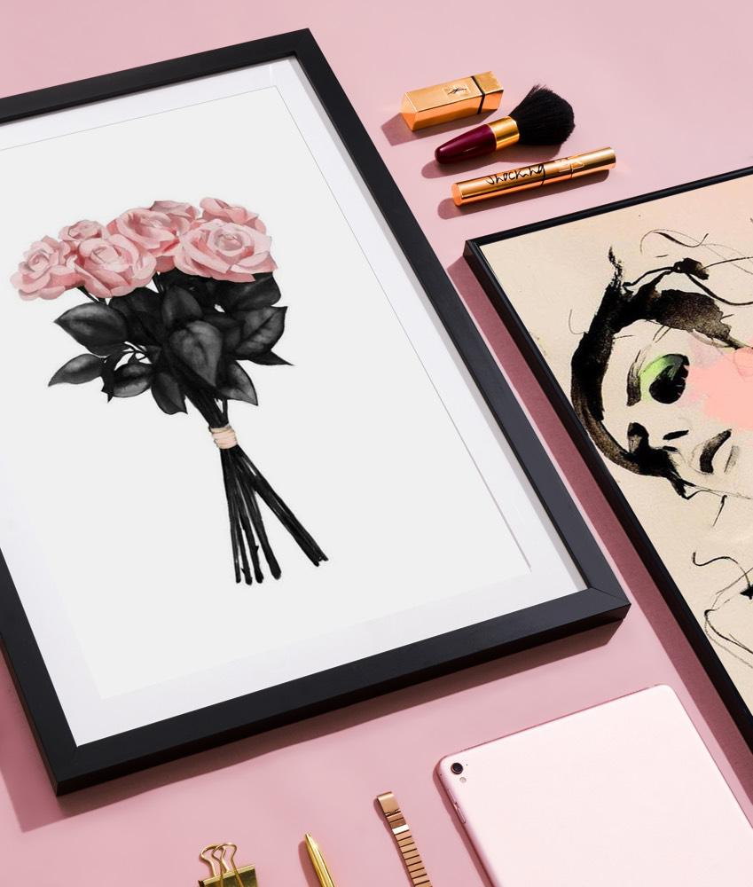 Portrait of a woman with roses in a wooden frame alongside other prints