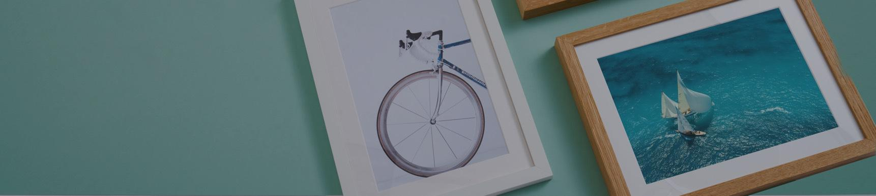 Framed photographs with bike and sailing boat motifs
