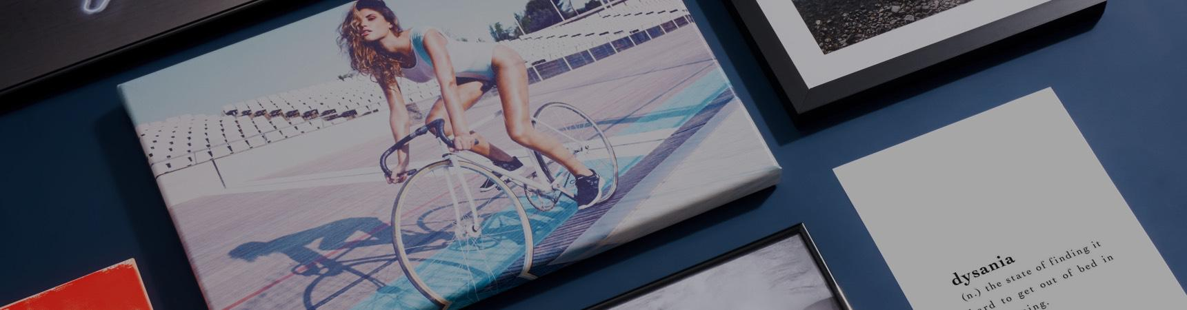 Canvas print with a model on a bicycle and other JUNIQE prints