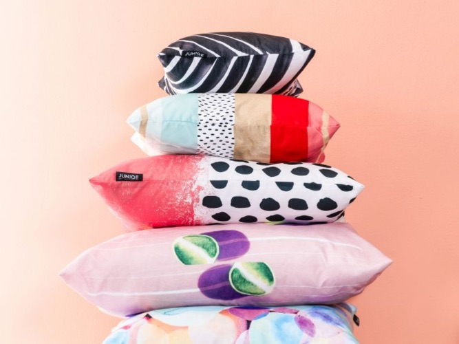 Pile of colourful patterned cushions