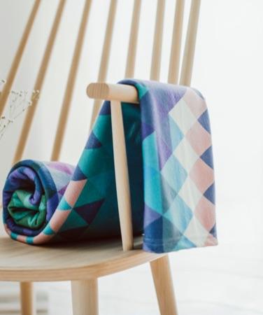 Diamond patterned colourful fleece blanket on chair