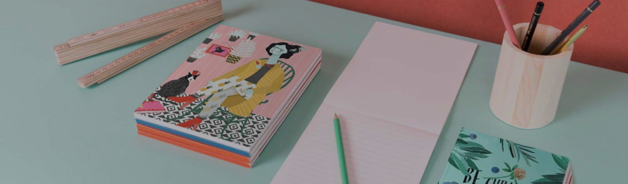 colourful juniqe stationery on table with pencils