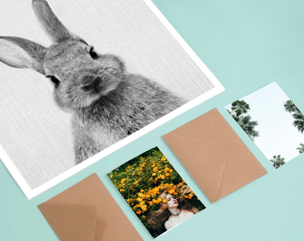 juniqe bunny poster on table with nature photography postcards