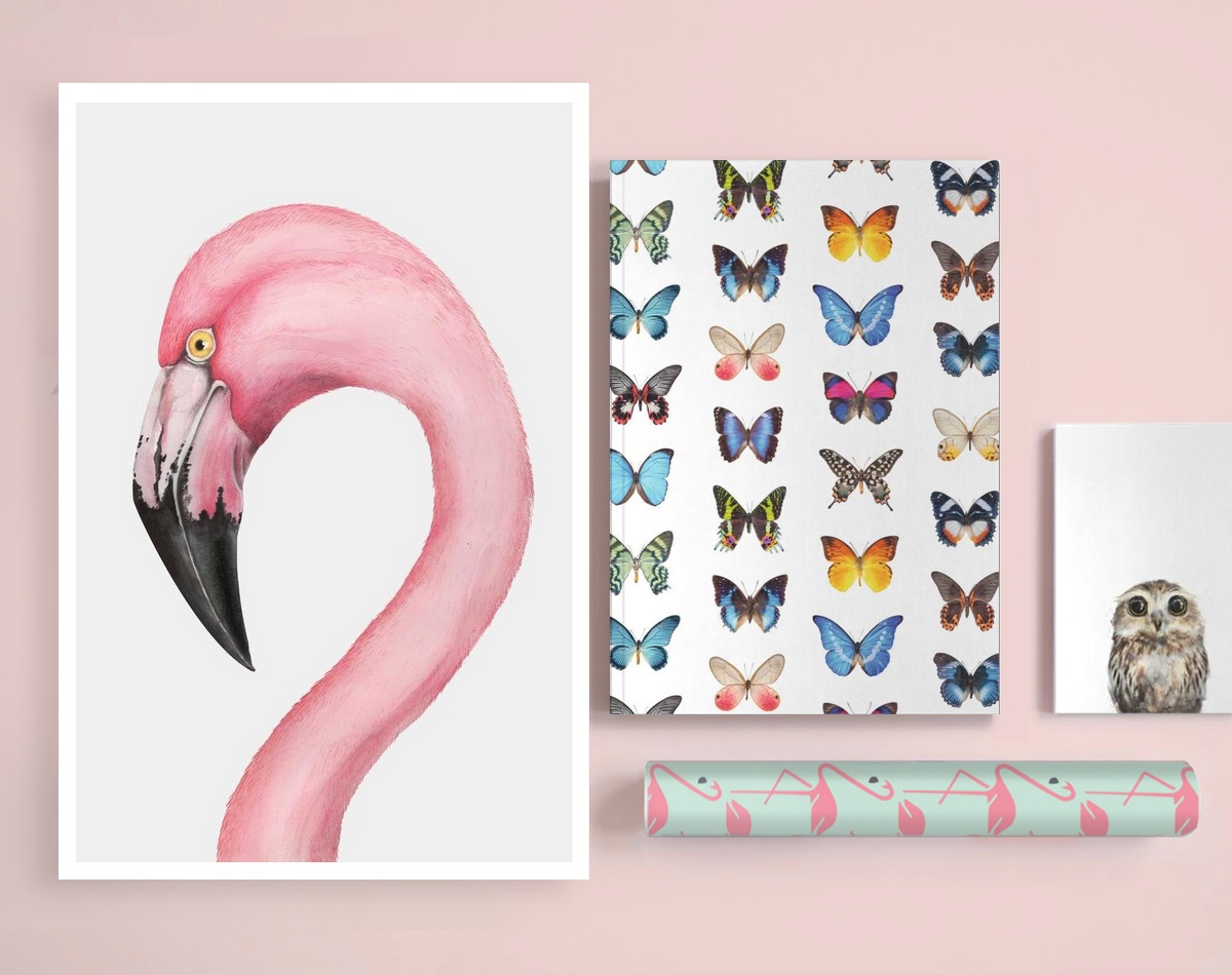 flamingo poster and wrapping paper next to butterfly notebook and owl notepad