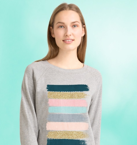 Model wearing grey sweatshirt with stripe design