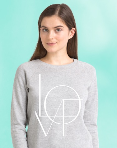 Woman wearing grey sweatshirt with LOVE by Honeymoon Hotel