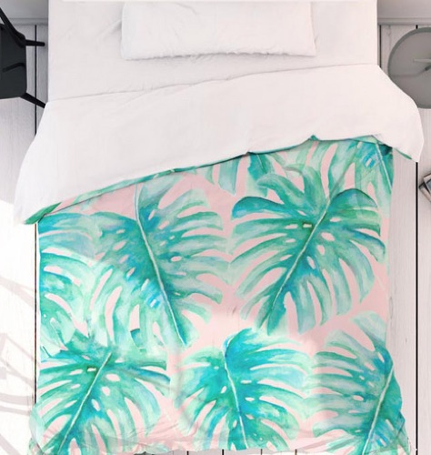 Bed with UNIQE monstera print bed linen