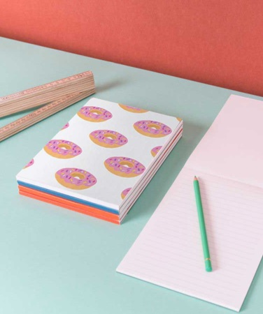 Pile of juniqe notepads with donut design and pencil