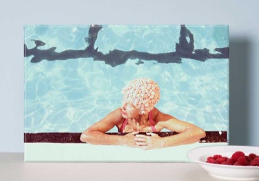 Canvas print of a woman bathing in a pool