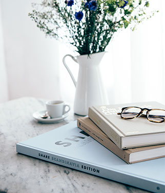 Share Scandinavia art book with flowers on a table