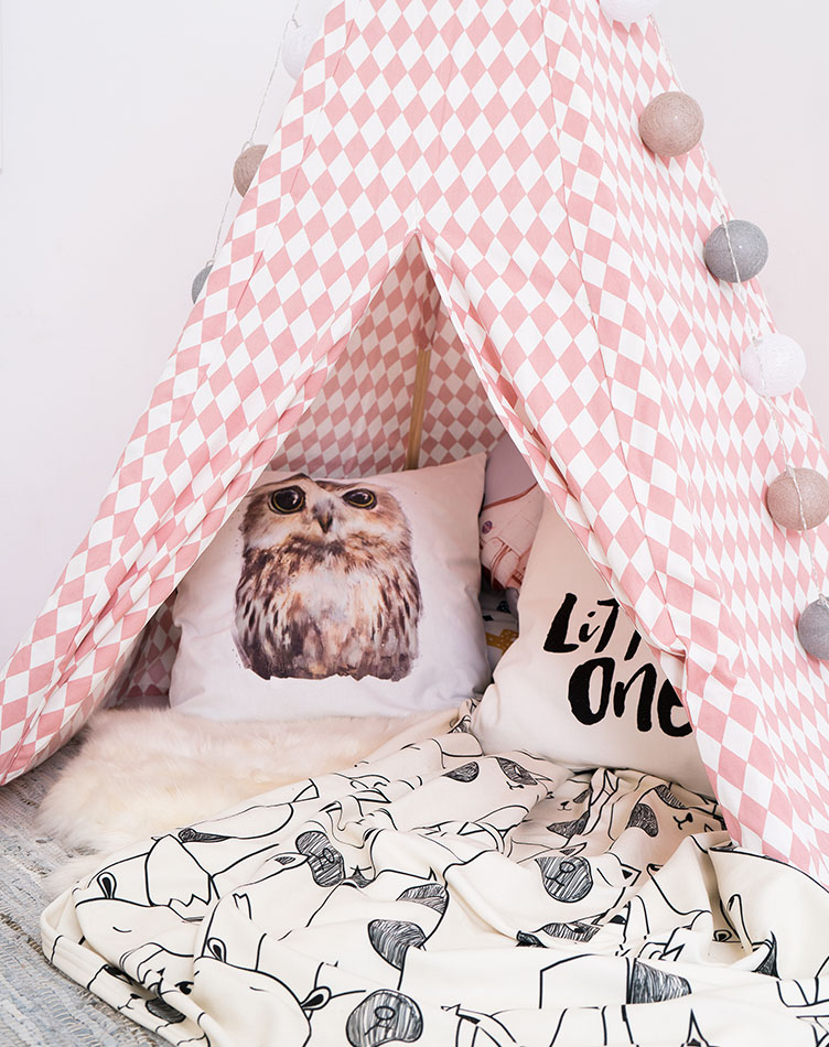 Kids teepee reading corner with cushions and fleece blanket