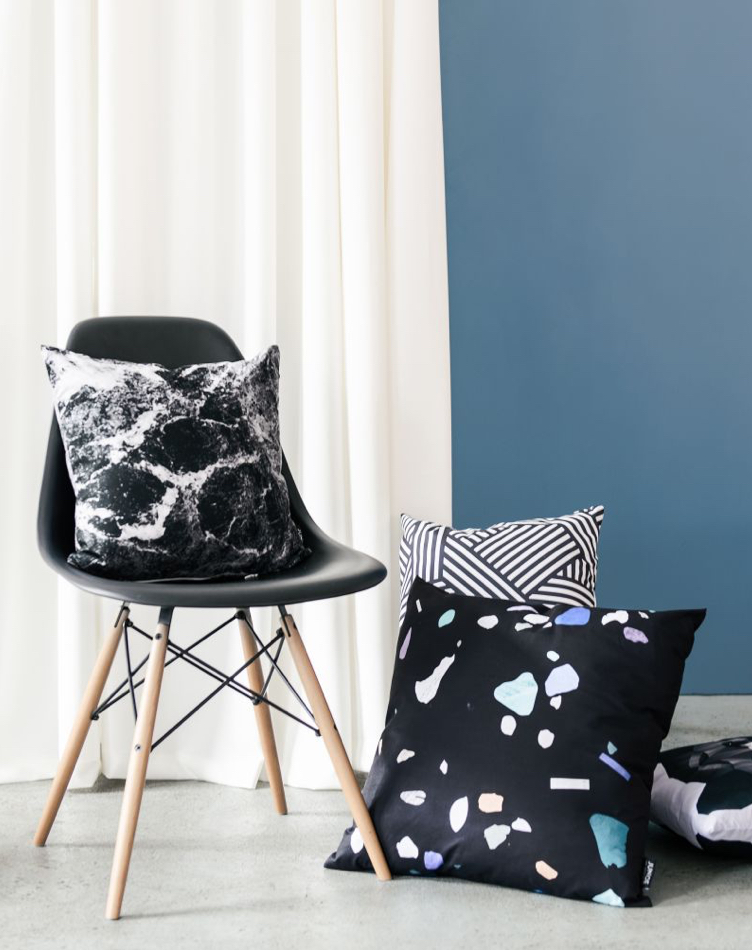Black and white cushions on chair