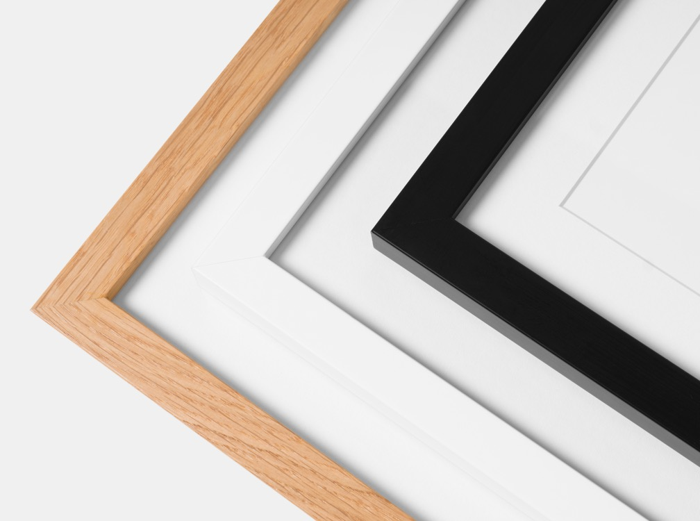 High-quality wooden frames available in black, white or oak.